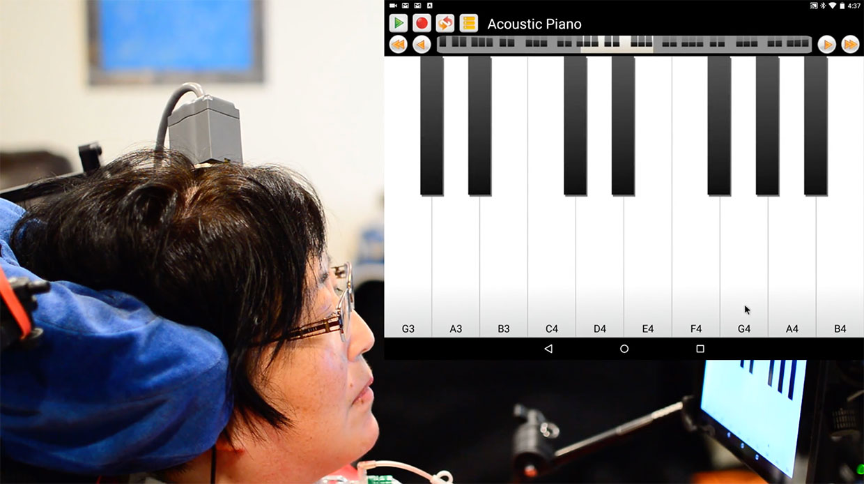 A participant in the BrainGate clinical trial directly controls a tablet computer through a brain-computer interface. The participant, a musician, played a snippet of 'Ode to Joy' on a digital piano interface.